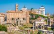 Scenic sight in the Roman Forum, with the Campidoglio Hill, the Vittoriano monument and the Settimio Severo Arch.