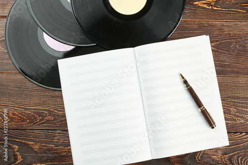 Photo Vinyl records and notebook for music notes