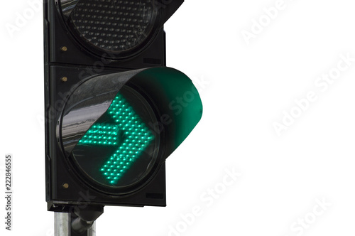 Photo  Close up  green arrow color on the traffic light on white background