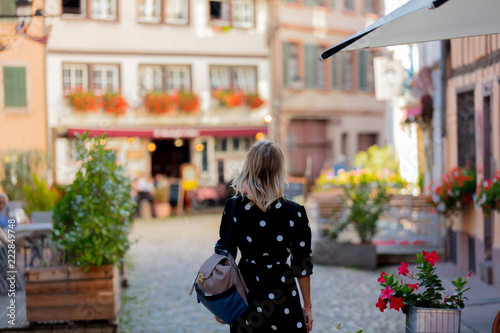 Young style girl in black dress walking down the street in Strasbourg, France, Autumn season time