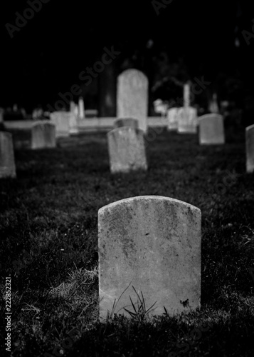 Valokuva Black and white rendering of graveyards with tombstones in cemetery - spooky Hal