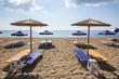 Umbrellas and sunbeds on Tsampika beach, Rhodes island, Greece