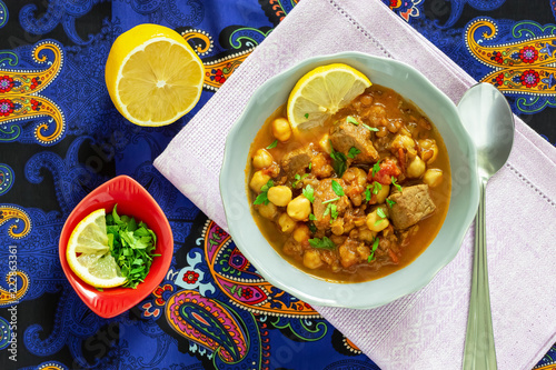 Moroccan lentil soup harira with meat, chickpeas, tomato and spices. Hearty, fragrant. Preparing for Iftar in the holy month of Ramadan.