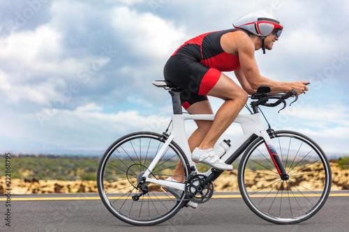 Obraz na płótnie Cycling sport athlete man biking on triathlon bike