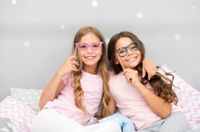 Birthday Girl. Children Posing With Grimaces Photo Booth Props. Pajamas Party In Bedroom. Friends Cute And Cheerful Posing With Eyeglasses Accessories. Girls Friends Having Fun Pajamas Party