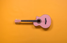 Pink Guitar On A Yellow Background