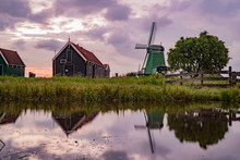 De Gekroonde Poelenburg Windmill And Dutch Houses With Reflection