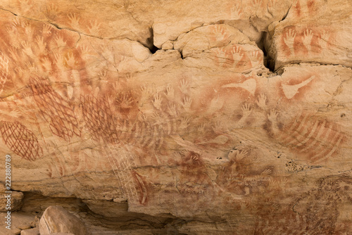 Aboriginal stencil rock art of hands, nets and stone axes at Cathedral Cave, Carnarvon Gorge, Queensland, Australia Wallpaper Mural