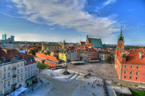 Beautiful colorful HDR aerial image of the famous Old town in Warsaw, Poland. The Royal Castle and Sigismund's Column called Kolumna Zygmunta on blue dramatic sky © aharond