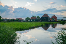 De Gekroonde Poelenburg, De Kat Windmill With Dutch Houses And Reflection