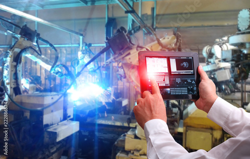 Fotografie, Tablou  Engineer hand using tablet with machine real time monitoring system software