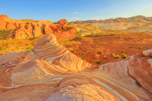 The Striped Landscape Of Popular Fire Wave Hike At Valley Of Fire State Park In Nevada, United States At Sunset Colors. Fire Wave Is One Of The Most Iconic Formations At Valley Of Fire.