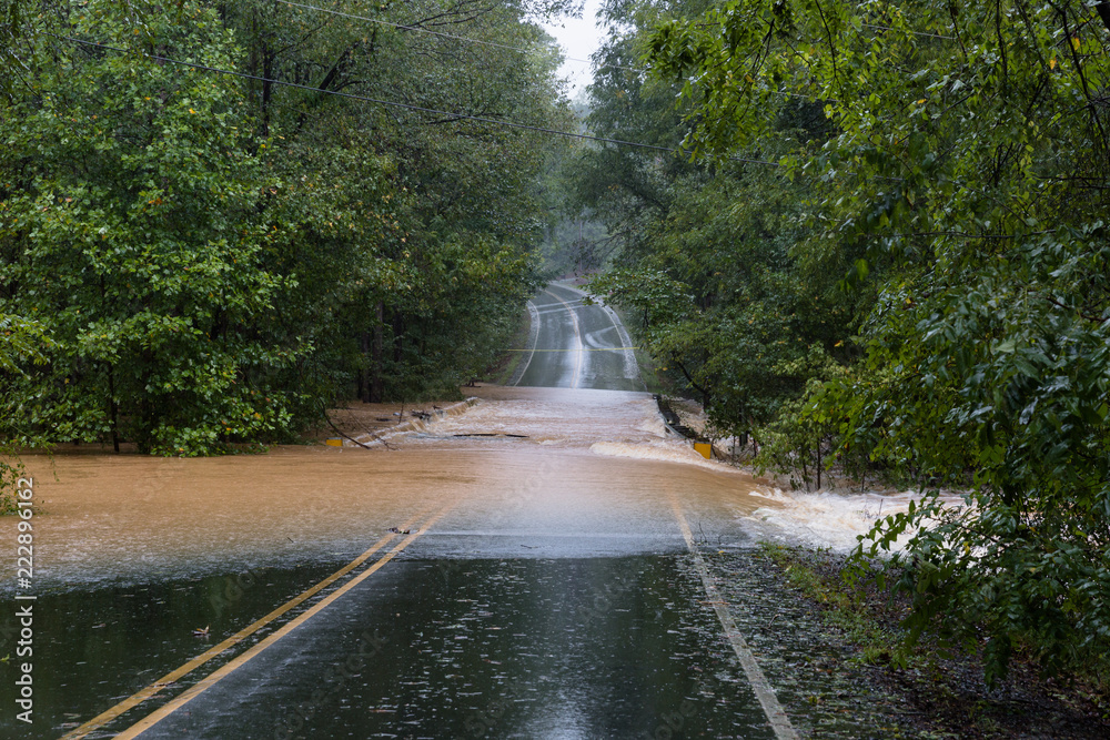 Fototapeta Waxhaw, North Carolina - September 16, 2018: Rainwater from Hurricane Florence washes out a bridge
