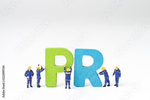 Fotografía  PR, Public Relations concept, miniature people staff help building color wooden
