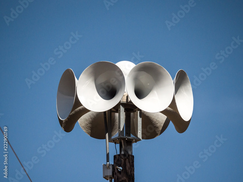 Stampa su Tela Close up photograph of several multi directional round amplified emergency siren  or noon time horns on top of a wooden pole in a small town in Wisconsin