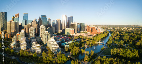 Aerial panoramic view of a beautiful modern cityscape during a vibrant sunny sunrise Canvas-taulu