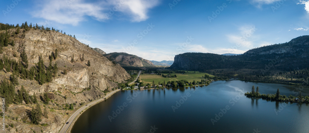 Aerial panoramic view of Okanagan Hwy near Vaseux Lake during a sunny summer day. Located between Oliver and Penticton, BC, Canada.