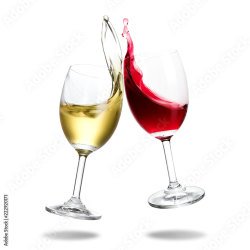 Cheers wine with splash out of glass isolated on white background.