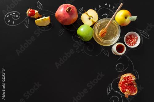 Fotografia  Pomegranate, apple and Honey for traditional holiday symbols Rosh hashanah (jewi