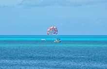 Boat With Parachute On The Caribbean Sea In Cancun