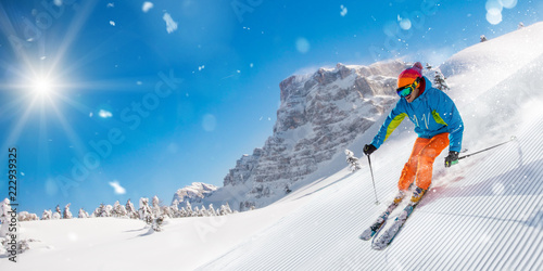 Canvas Prints Winter sports Skier skiing downhill in high mountains