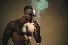 Tattooed Man With Cigar. Cigar...