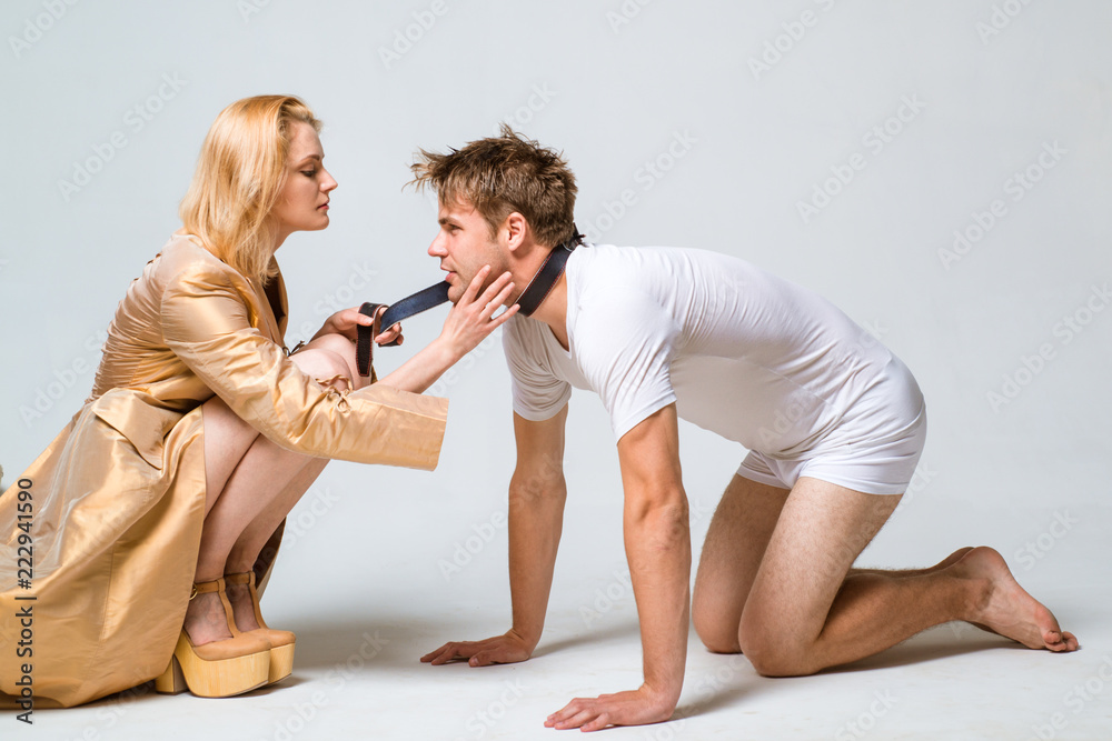 Fototapeta Domination and Submission. Woman and man playing domination games. Dominate obey undress seduce a partner.