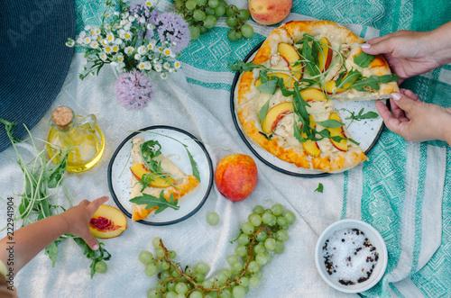 Fotografie, Obraz  Pizza with chicken, peaches, cream cheese and arugula