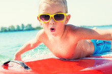 Boy Swimming On Stand Up Paddle Board.Water Sports , Active Lifestyle.