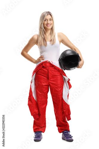 Fototapeta Woman racer holding a helmet