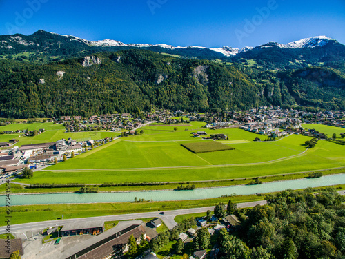 wonderful landscape of the Austrian village. Valley among the Swiss Alps. Houses near a lake among the mountains. View from above. European tourism. Beautiful place for rest and travel