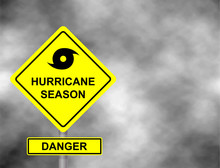 Hurricane Sign Road. Yellow Hazard Warning Sign Against Grey Sky - Tornado Warning, Bad Weather Warning, Vector Illustration. Hurricane Season With Symbol Sign Against A Stormy Background.