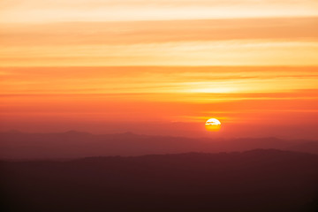 Dramatic sunset and sunrise over mountain morning twilight evening sky.