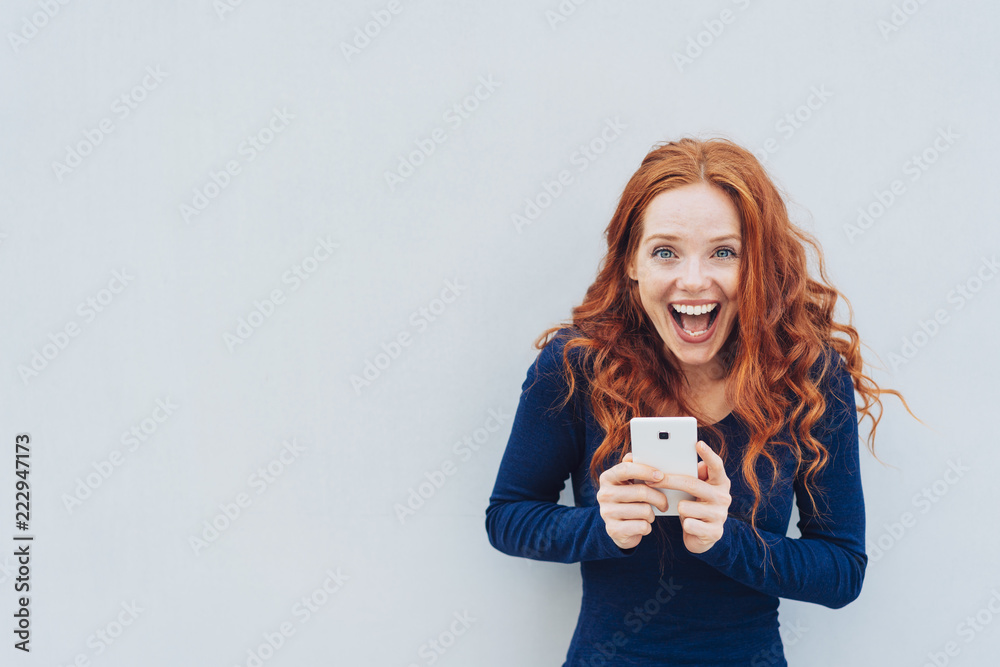 Fototapety, obrazy: Vivacious young woman laughing at a good joke