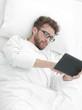 background image . man reading on digital tablet.