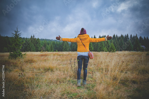 Fototapety, obrazy: Girl with arms wide open in autumn / fall season surroundings.