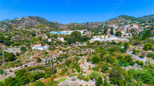 Foto op Plexiglas Groene Aerial view of Agros village settlement on mountain Troodos, Limassol district, Cyprus. Bird's eye view of traditional houses with ceramic tile roof, church, countryside and rural landscape from above
