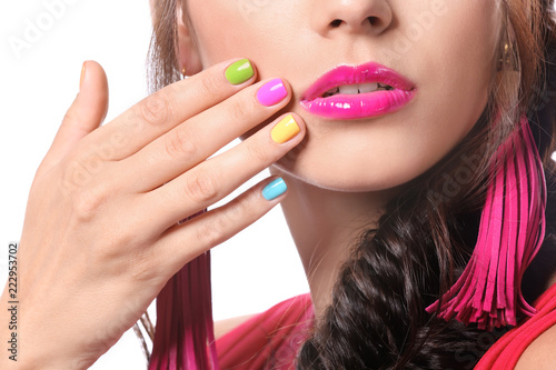 Canvas Print Beautiful young woman with colorful manicure on white background, closeup