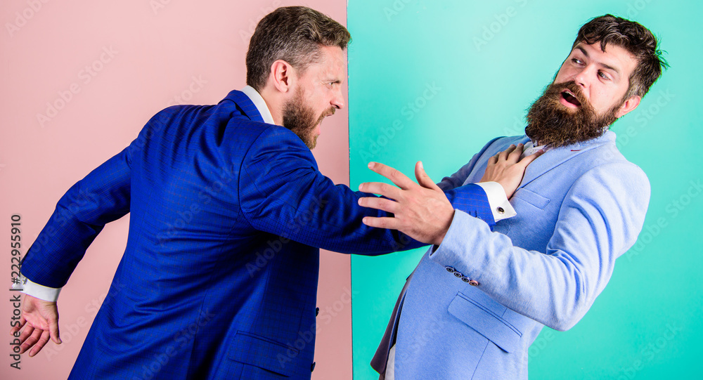Fototapety, obrazy: Business competition and confrontation. Domination and subordination. Hostile situation between opposing colleagues. Business partners competitors office colleagues tense faces conflict situation