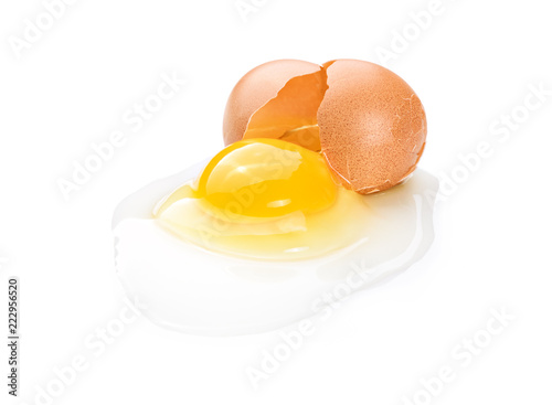 Broken brown chicken egg on white background
