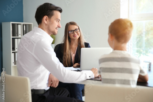 Fotografía  Young man and his son meeting with headmistress at school