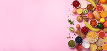 Organic Food Frame. Banner. Healthy Breakfast Ingredients. Oat And Corn Flakes, Eggs, Nuts, Fruits, Berries, Toast, Milk, Yogurt, Orange, Banana, Peach On Pink Background. Top View, Copy Space