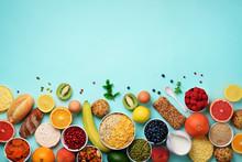 Healthy Breakfast Ingredients, Food Frame. Oat And Corn Flakes, Eggs, Nuts, Fruits, Berries, Toast, Milk, Yogurt, Orange, Banana, Peach On Blue Background. Top View, Copy Space. Flat Lay