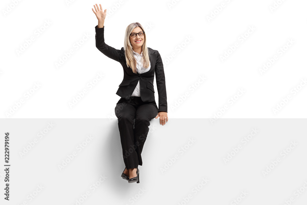 Fototapety, obrazy: Businesswoman seated on a panel waving