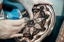 Hands Making Engraving Job