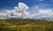 Wind Power Station Among Rural Landscape