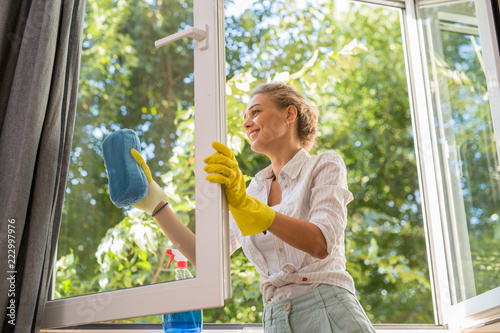 woman cleaning windows in her home