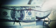 US Dollar Money Wrapped In Barbed Wire As Symbol Of Economic Warfare, Sanctions And Embargo Busting