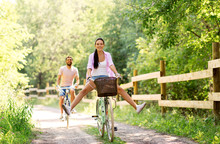 Cycling, Leisure And Lifestyle Concept - Happy Young Couple With Bicycles At Summer Park