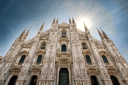 Fototapeta Milan Cathedral or Duomo di Milano with sun and sky, Milan, Italy
